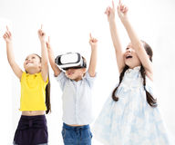 Happy kids using virtual reality headset. Group of happy kids using virtual reality headset Stock Image