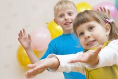 Happy kids are waiting for gifts Royalty Free Stock Photo