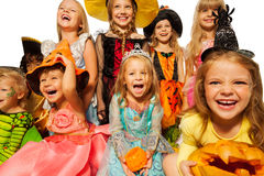 Happy kids wearing Halloween costumes close-up Stock Image