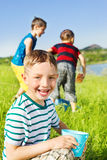 Happy kids in wet clothing Stock Image