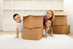 Happy kids and woman in a new home Royalty Free Stock Photo