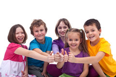 Happy kids working as a team. Giving thumbs up sign stock images