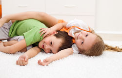 Happy kids wrestling in their room Royalty Free Stock Photos