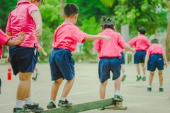 Kindergarten students are exercising in morning. stock photography