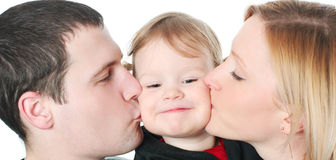 Happy kiss. Funny young family isolated on white stock image