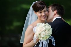 Happy Kiss of Newlyweds Stock Photos