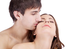 Happy kissing couple embracing, woman pregnant Royalty Free Stock Photos