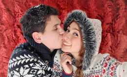 Happy kissing couple having fun in christmas time Stock Photography