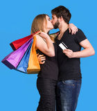 Happy kissing couple with shopping bags Royalty Free Stock Photo