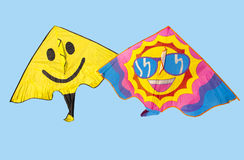 Happy kites. With face and glasses  on blue showing summer sunny day Royalty Free Stock Photo
