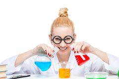Happy lab assistant mixes fluids in a laboratory Royalty Free Stock Photo