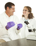 Happy Lab Technicians. Two lab techs enjoy working on a blood sample together.  Isolated on white Royalty Free Stock Image