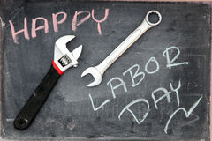 Happy Labor Day. On blackboard with wrench Stock Photography