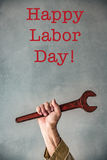 Happy Labor day concept. Senior man holding old metal wrench. Happy Labor day concept Stock Image