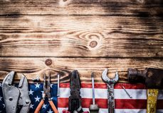 Happy Labor day. Construction tools. Copy space for text on wood background royalty free stock photography