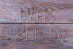 Happy Labor Day inscription. Text made by screws. Congratulation in original manner Stock Photos