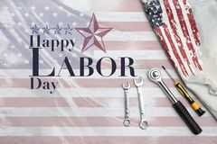 Happy Labor day logo design on abstract American flag. With steel tool and USA flag print on jean fabric Vector Illustration