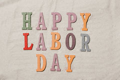 Happy Labor Day on the sandy beach background. Happy Labor Day w Stock Photography