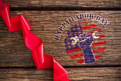 Composite image of happy labor day text over cropped hand holding tools Royalty Free Stock Photos