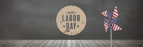 Happy labor day text and USA wind catcher in front of wall. Digital composite of Happy labor day text and USA wind catcher in front of wall Stock Photo