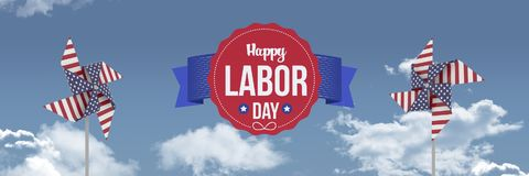 Happy labor day text and USA wind catchers in front of sky Royalty Free Stock Photo