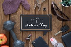 Happy Labour Day Fitness and healthy active wellness lifestyle background concept. Gentleman`s accessories, dumbbells, and apples. On wooden background with stock image