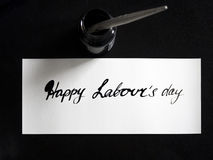 Happy labour`s day calligraphy and lattering post card. Top View with calligraph in ink tank stock image