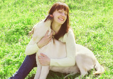 Happy labrador retriever dog and owner woman on the grass Royalty Free Stock Photography