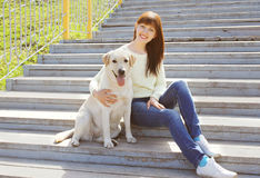 Happy labrador retriever dog and owner woman together Royalty Free Stock Photos