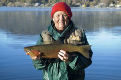 Happy Lady Angler. Rainbow trout 4.5lb caught by happy lady angler stock photos