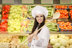Happy Lady Chef with Big Spoon Shopping for Vegetables Royalty Free Stock Photography