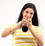 Happy lady with the clarinet Royalty Free Stock Photography