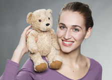 Happy lady with cuddly toy playing around Royalty Free Stock Images