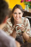 Happy Lady with Friend. Happy young Caucasian lady with mug and friend Stock Photography