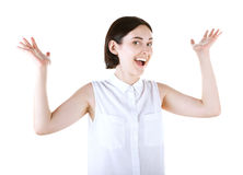 A happy lady with her hands up. A lovely casual girl isolated on a white background. Cheerfulness, happiness and success concept. Stock Photos