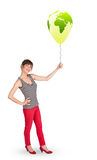 Happy lady holding a green globe balloon Stock Image