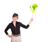 Happy lady holding a green globe balloon Royalty Free Stock Photography