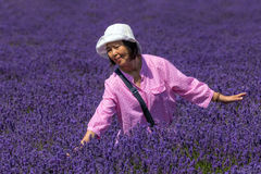 Happy Lady in Lavender Field, Worcestershire, England. A smiling female Chinese tourist posing in a Worcestershire Lavender field stock photos