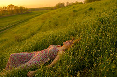 Happy lady lying on the meadow Royalty Free Stock Photo