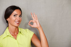 Happy lady with ok sign and toothy smile Stock Photos