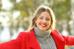 Happy lady posing looking at camera in winter Royalty Free Stock Photo