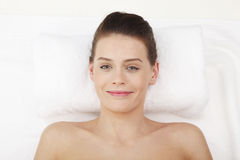 Happy lady relaxing in massage salon Stock Images