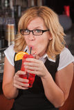 Happy Lady Sipping Drink Royalty Free Stock Photography