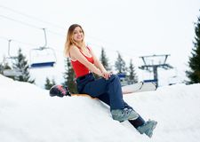 Woman skier on the top of the snowy hill with skis at ski resort Royalty Free Stock Images