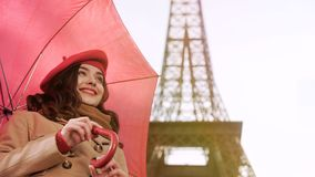 Happy lady standing under umbrella in Paris, smiling and waiting for date Stock Images