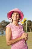 Happy lady with sunflower in park Stock Photography