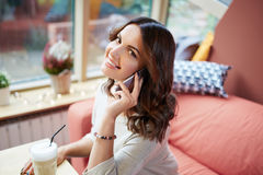 Happy lady talking on mobile Royalty Free Stock Photos