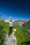 Happy lady on top of mountain Royalty Free Stock Photos