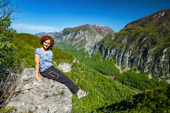 Happy lady on top of mountain Stock Image