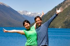 Happy by the lake. A couple having fun by the lake, New zealand Royalty Free Stock Image